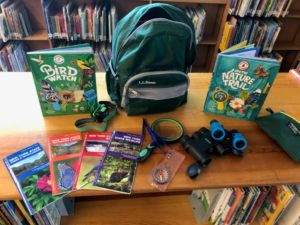 Backpack on Bookshelf with Nature Disccovery Supplies